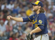 Milwaukee Brewers starting pitcher Corbin Burnes stretches between batters during the fifth inning of a baseball game against the Cleveland Indians in Cleveland, Saturday, Sept. 11, 2021. (AP Photo/Phil Long)