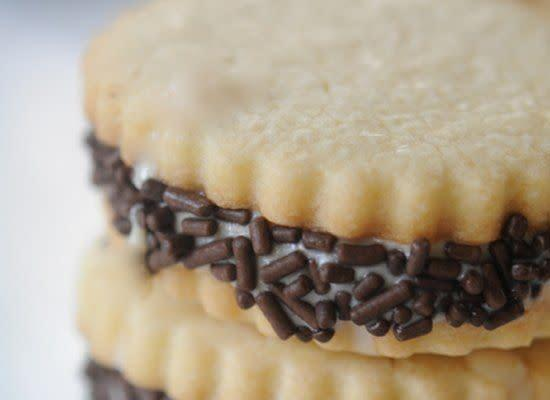 """Who needs a Reese's Peanut Butter Cup when they can have peanut butter ice cream, chocolate sprinkles and sugar cookies all in one? <strong>Get the <a href=""""http://cupcakesandcashmere.com/peanut-butter-ice-cream-sandwiches/"""" rel=""""nofollow noopener"""" target=""""_blank"""" data-ylk=""""slk:Peanut Butter Ice Cream Sandwiches recipe"""" class=""""link rapid-noclick-resp"""">Peanut Butter Ice Cream Sandwiches recipe</a> by Cupcakes and Cashmere</strong>"""