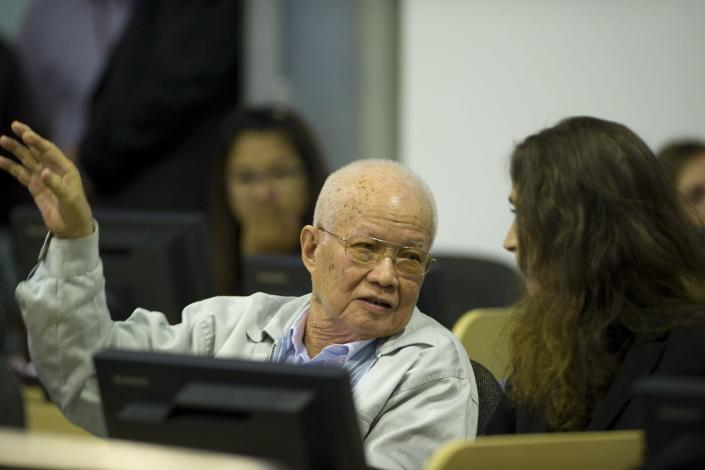 """In this handout photo courtesy of the ECCC, Cambodia's former Khmer Rouge President Khieu Samphan (L) sits at the Extraordinary Chambers in the Courts of Cambodia (ECCC) as his verdict is delivered on the outskirts of Phnom Penh August 7, 2014. The U.N.-backed tribunal in Cambodia sentenced the top two surviving cadres of the Khmer Rouge regime to life in jail on Thursday after finding them guilty of crimes against humanity for their part in the 1970s """"killing fields"""" revolution. REUTERS/Mark Peters/ECCC/Handout via Reuters (CAMBODIA - Tags: POLITICS CIVIL UNREST CRIME LAW) ATTENTION EDITORS - THIS PICTURE WAS PROVIDED BY A THIRD PARTY. REUTERS IS UNABLE TO INDEPENDENTLY VERIFY THE AUTHENTICITY, CONTENT, LOCATION OR DATE OF THIS IMAGE. FOR EDITORIAL USE ONLY. NOT FOR SALE FOR MARKETING OR ADVERTISING CAMPAIGNS. NO SALES. NO ARCHIVES. THIS PICTURE IS DISTRIBUTED EXACTLY AS RECEIVED BY REUTERS, AS A SERVICE TO CLIENTS"""