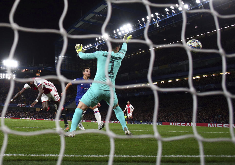Ajax's Quincy Promes, left, scores his side's second goal during the Champions League, group H, soccer match between Chelsea and Ajax, at Stamford Bridge in London, Tuesday, Nov. 5, 2019. (AP Photo/Ian Walton)