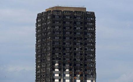 FILE PHOTO - The burnt out remains of the Grenfell apartment tower is seen in North Kensington, London, Britain