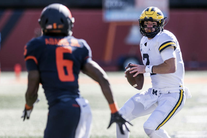 Michigan quarterback Shea Patterson (2) looks to throw as Illinois' Tony Adams (6) defends in the second half of an NCAA college football game, Saturday, Oct.12, 2019, in Champaign, Ill. (AP Photo/Holly Hart)