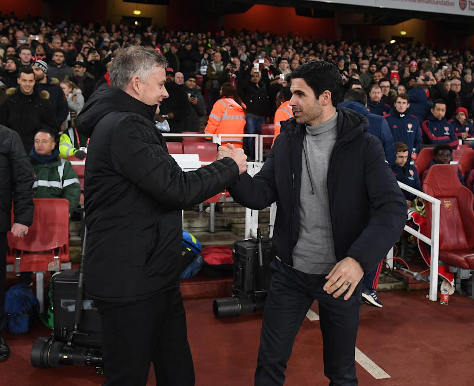 LONDON, ENGLAND - JANUARY 01: Mikel Arteta the Arsenal Head Coach greets Ole Gunnar Solskjaer the Manager of Man Utd before the Premier League match between Arsenal FC and Manchester United at Emirates Stadium on January 01, 2020 in London, United Kingdom. (Photo by David Price/Arsenal FC via Getty Images)