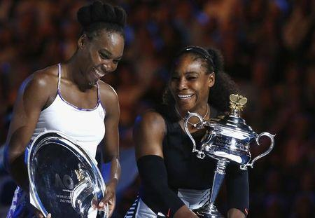 Tennis - Australian Open - Melbourne Park, Melbourne, Australia - 28/1/17 Serena Williams of the U.S. reacts as she holds her trophy after winning her Women's singles final match against Venus Williams of the U.S. REUTERS/Thomas Peter/Files