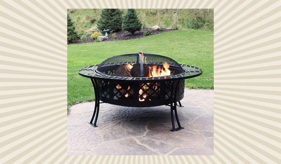 You've always wanted to be the kind of person that has a fire pit in your backyard. Make that a reality. (Photo: Walmart)