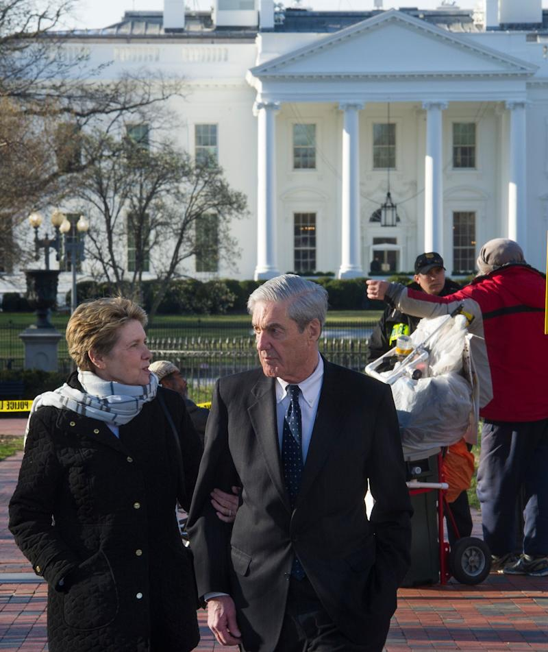 Special Counsel Robert Mueller, and his wife Ann, walk past the White House, to St. John's Episcopal Church for morning services on Sunday, March 24, 2019 in Washington. Mueller closed his long and contentious Russia investigation with no new charges, ending the probe that has cast a dark shadow over Donald Trump's presidency.
