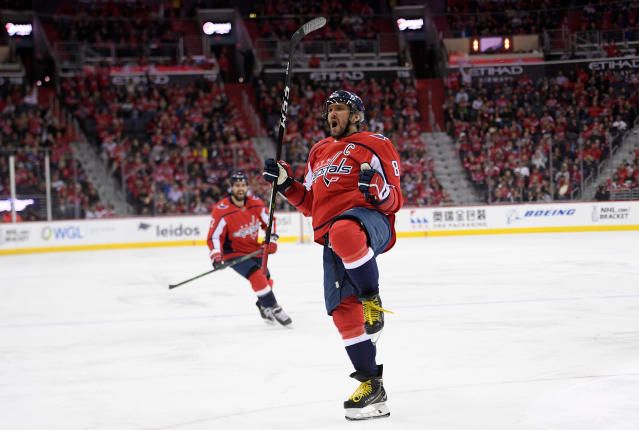 Washington Capitals left wing Alex Ovechkin, of Russia, celebrates his goal during the third period of an NHL hockey game against the New Jersey Devils, Saturday, April 7, 2018, in Washington. The Capitals won 5-3. (AP Photo/Nick Wass)