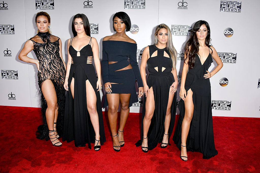 <p>Dinah Jane Hansen, Lauren Jauregui, Normani Hamilton, Ally Brooke, and Camila Cabello of Fifth Harmony matched in black and cutouts. <em>(Photo: Getty Images)</em> </p>