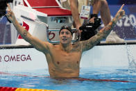 Caeleb Dressel, of the United States, celebrates after winning the men's 100-meter freestyle final at the 2020 Summer Olympics, Thursday, July 29, 2021, in Tokyo, Japan. (AP Photo/Martin Meissner)