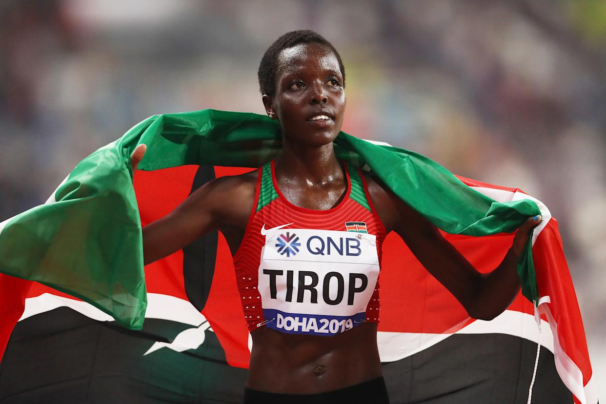 DOHA, QATAR - SEPTEMBER 28:  Agnes Jebet Tirop of Kenya celebrates winning bronze in the Women's 10,000 Metres final during day two of 17th IAAF World Athletics Championships Doha 2019 at Khalifa International Stadium on September 28, 2019 in Doha, Qatar. (Photo by Alexander Hassenstein/Getty Images for IAAF)