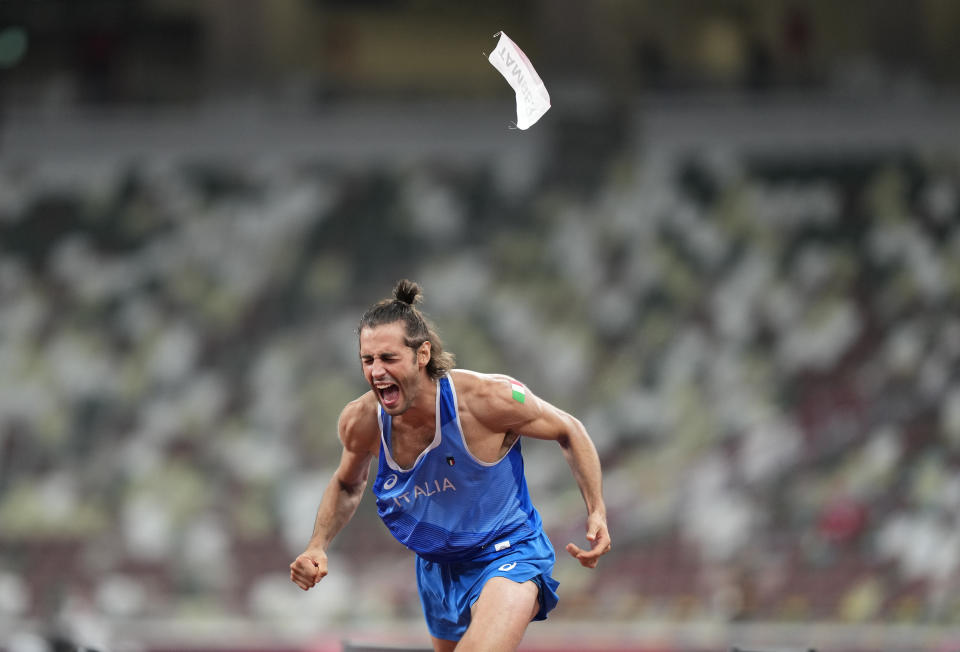 Gianmarco Tamberi, of Italy reacts after he wins joint gold with Mutaz Barshim of Qatar in the final of the men's high jump at the 2020 Summer Olympics, Sunday, Aug. 1, 2021, in Tokyo, Japan. (AP Photo/Martin Meissner)