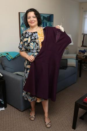 Lisa Batitto shows a dress she rented from a clothing rental site at her home in Montclair, New Jersey