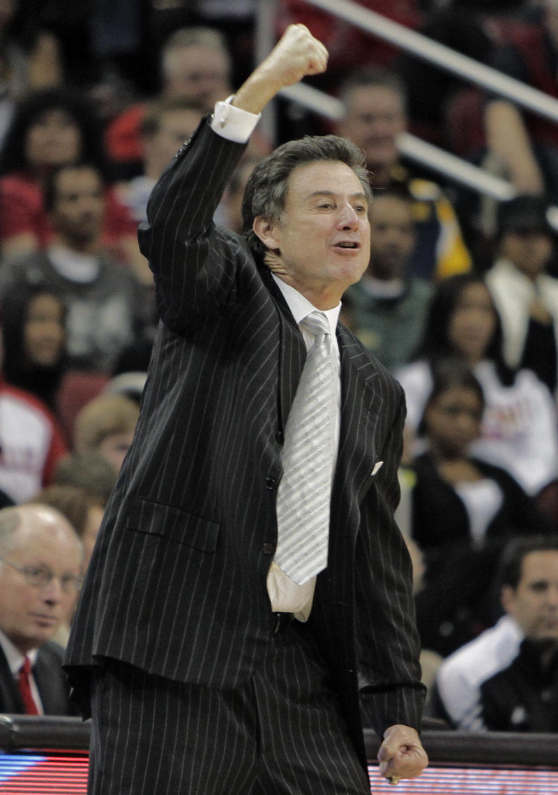 Louisville coach Rick Pitino gestures as he encourages his team to come from behind in the second half to defeat No. 20 UNLV 77-69 in their NCAA college basketball game in Louisville, Ky., Saturday, Dec. 11, 2010.  (AP Photo/Garry Jones)
