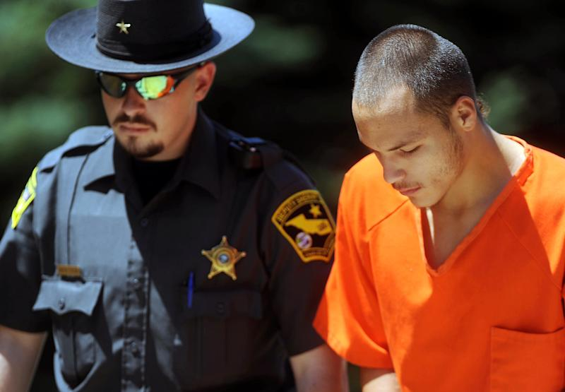 In this July 17, 2012, file photo, Taylor Cournoyer is escorted into Charles Mix County Courthouse in Lake Andes, S.D. on for the preliminary hearing for the death of two-year-old RieLee Lovell. Taylor Cournouyer and his wife Laurie Cournoyer are charged with failing to notify police of the death of a 2-year-old girl found in a closet at their rural South Dakota home. They also face five counts of child abuse and drug charges. The Cournoyers are accused of using sleeping pills, methamphetamine and marijuana during the day and a half in July when the child's death still hadn't been reported. (AP Photo/The Argus Leader, Jay Pickthorn) NO SALES