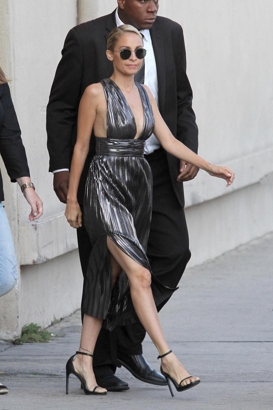 <p>The reality star arrived to a taping of the Jimmy Kimmel Live to promote the new season of her show, <i>Candidly Nicole</i>, in a dazzling silver pleated dress.<br><br></p>