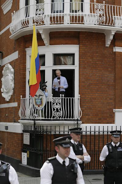"""Julian Assange, founder of WikiLeaks makes a statement from a balcony of the Equador Embassy in London, Sunday, Aug. 19, 2012. Assange called on United States President Barack Obama to 'end a """"witch hunt"""" against the secret-spilling WikiLeaks organization.(AP Photo/Kirsty Wigglesworth)"""