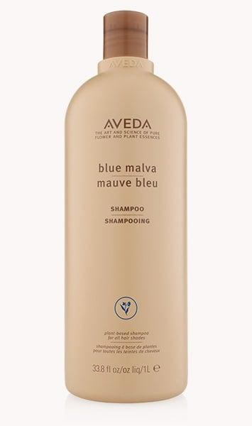 <p>The blue tones in this oversized <span>Aveda Blue Malva Shampoo</span> ($57) bottle will enhance your warm tones. It's intended for people who are naturally brunette.</p>