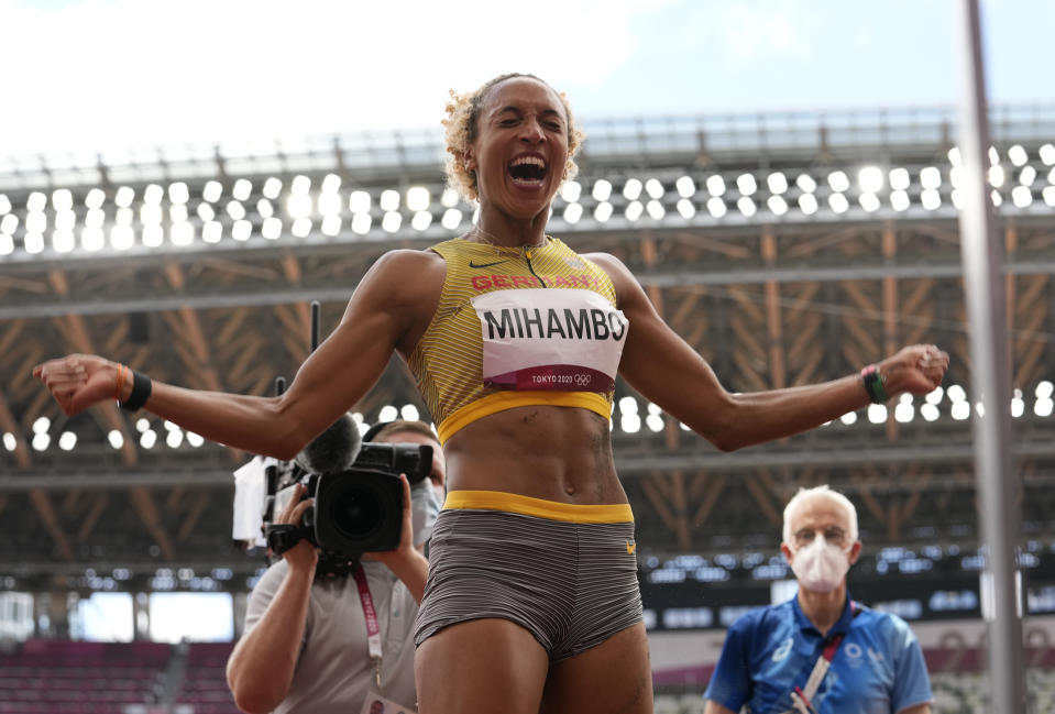 Malaika Mihambo, of Germany celebrates after winning the gold medal in the women's long jump final at the 2020 Summer Olympics, Tuesday, Aug. 3, 2021, in Tokyo, Japan. (AP Photo/Martin Meissner)
