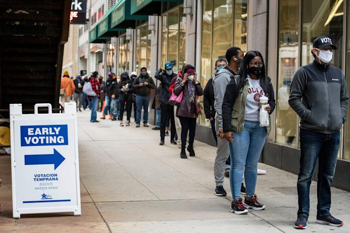 Hundreds of people wait in line to early vote in Chicago on  Oct. 1, 2020.