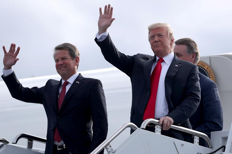 U.S. President Donald Trump and republican candidate for Georgia governor Brian Kemp arrive to attend a campaign rally at Middle Georgia Regional Airport in Macon, Georgia, U.S., November 4, 2018. REUTERS/Jonathan Ernst