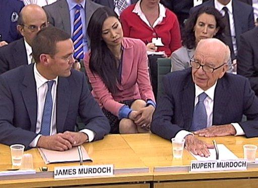 Rupert Murdoch's wife Wendi Deng (C) looks on as BSkyB Chairman James Murdoch and News Corp Chief Executive and Chairman Rupert Murdoch (R) appear before a parliamentary committee on phone hacking at Portcullis House in London July 19, 2011. (REUTERS/Parbul TV via Reuters Tv)