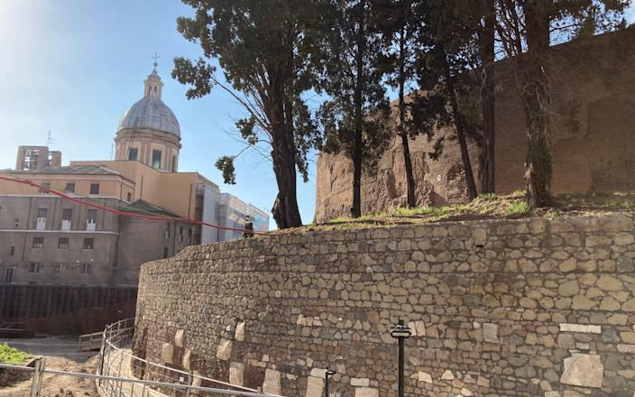 Part of the exterior of the mausoleum, with a Renaissance church in the background - Nick Squires