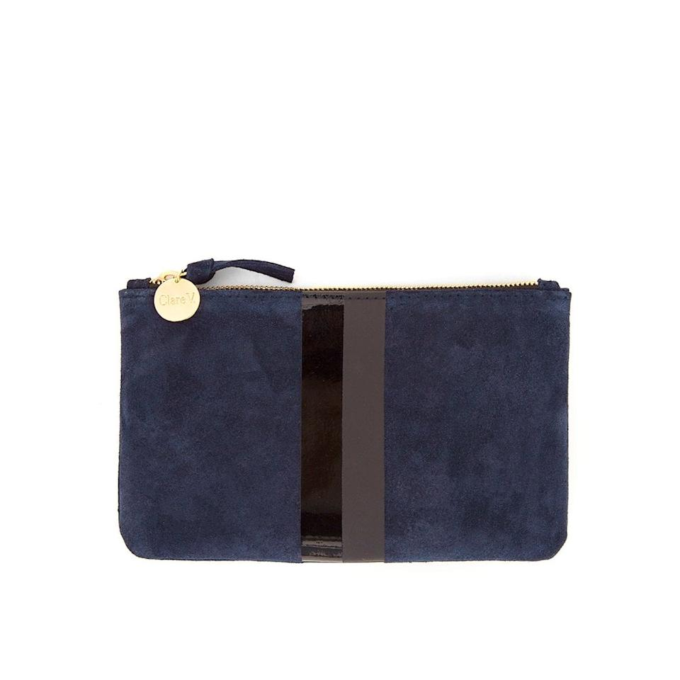 "<p>This <a href=""https://www.popsugar.com/buy/Clare-V-Wallet-Clutch-477769?p_name=Clare%20V.%20Wallet%20Clutch&retailer=clarev.com&pid=477769&price=135&evar1=savvy%3Auk&evar9=46479463&evar98=https%3A%2F%2Fwww.popsugar.com%2Fsmart-living%2Fphoto-gallery%2F46479463%2Fimage%2F46479464%2FClare-V-Wallet-Clutch&list1=shopping%2Ctravel%2Cbags%2Ctraveling%2Corganization%2Ctravel%20tips&prop13=api&pdata=1"" rel=""nofollow"" data-shoppable-link=""1"" target=""_blank"" class=""ga-track"" data-ga-category=""Related"" data-ga-label=""https://www.clarev.com/collections/clutches/products/wallet-clutch-navy-suede-w-glossy-matte-black-stripes"" data-ga-action=""In-Line Links"">Clare V. Wallet Clutch</a> ($135) is the exact bag I use, and I think it's the perfect size; big enough to hold everything, but small enough to still feel compact.</p>"