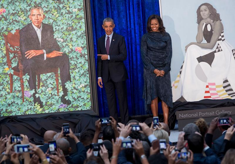Former U.S. President Barack Obama and former first lady Michelle Obama stand beside their portraits after their unveiling at the Smithsonian's National Portrait Gallery in Washington, D.C., Feb. 12.