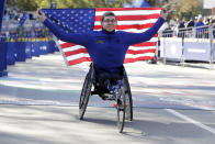 Daniel Romanchuk, of Mount Airy, Md., poses for photos as the winner the pro wheelchair men's division of the New York City Marathon, in New York's Central Park, Sunday, Nov. 3, 2019. (AP Photo/Richard Drew)