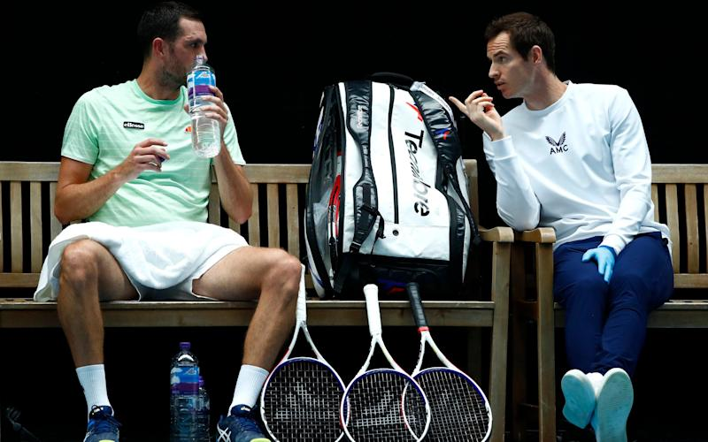 Andy Murray gives James Ward a few pointers as his coach  - GETTY IMAGES