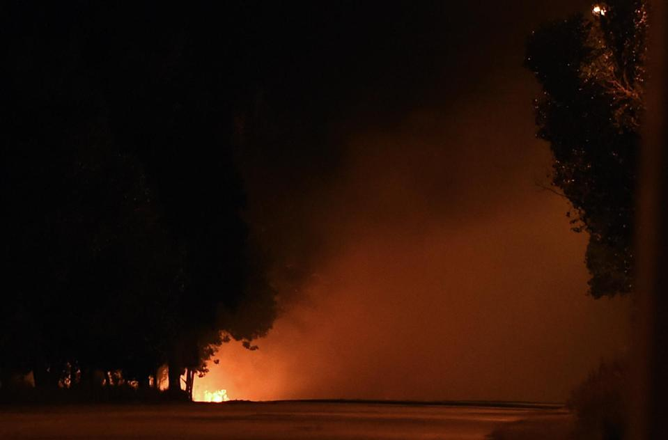 A Ukrainian army checkpoint on a road leading to Russia burns after loud explosions were heard on the outskirts of the key southeastern Ukrainian port city of Mariupol, on September 6, 2014 (AFP Photo/Philippe Desmazes)