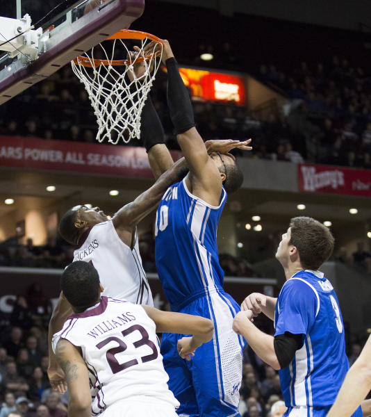 Creighton center Gregory Echenique (00) gets a hand to the face from Missouri State forward Keith Pickens while attempting a dunk during the first half of an NCAA college basketball game Friday, Jan. 11, 2013, in Springfield, Mo. (AP Photo/David Welker)
