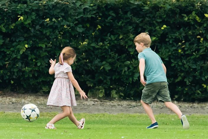 Prince George and Princess Charlotte played soccer during their dad's polo match. (Photo: Getty)