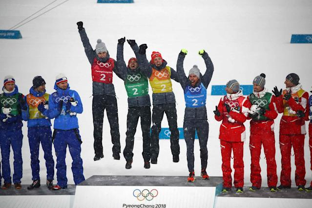 Nordic Combined Events - Pyeongchang 2018 Winter Olympics - Men's Team 4 x 5 km Final - Alpensia Cross-Country Skiing Centre - Pyeongchang, South Korea - February 22, 2018 - The German team celebrates winning gold, next to silver medallists Norway and bronze medallists Austria. REUTERS/Carlos Barria