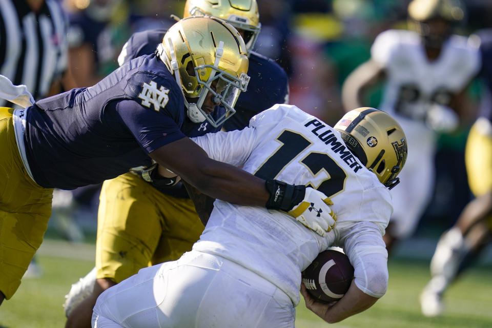 Notre Dame defensive lineman Justin Ademilola (9) sacks Purdue quarterback Jack Plummer (13) during the second half of an NCAA college football game in South Bend, Ind., Saturday, Sept. 18, 2021. Notre Dame defeated Purdue 27-13. (AP Photo/Michael Conroy)