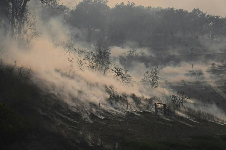 A hillside smolders in the Silverado Fire October 26, 2020 in Irvine, California.