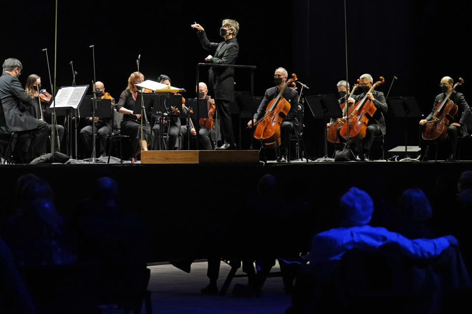 CORRECTS SPELLING OF FIRST NAME TO ESA INSTEAD OF ESSA - Guest conductor Esa-Pekka Salonen, music director of the San Francisco Symphony and principal conductor of London's Philharmonia Orchestra, leads the New York Philharmonic as the group performed together before a live audience of 150 people for the first time since March 10, 2020, at The Shed in Hudson Yards, Wednesday, April 14, 2021, in New York. (AP Photo/Kathy Willens)