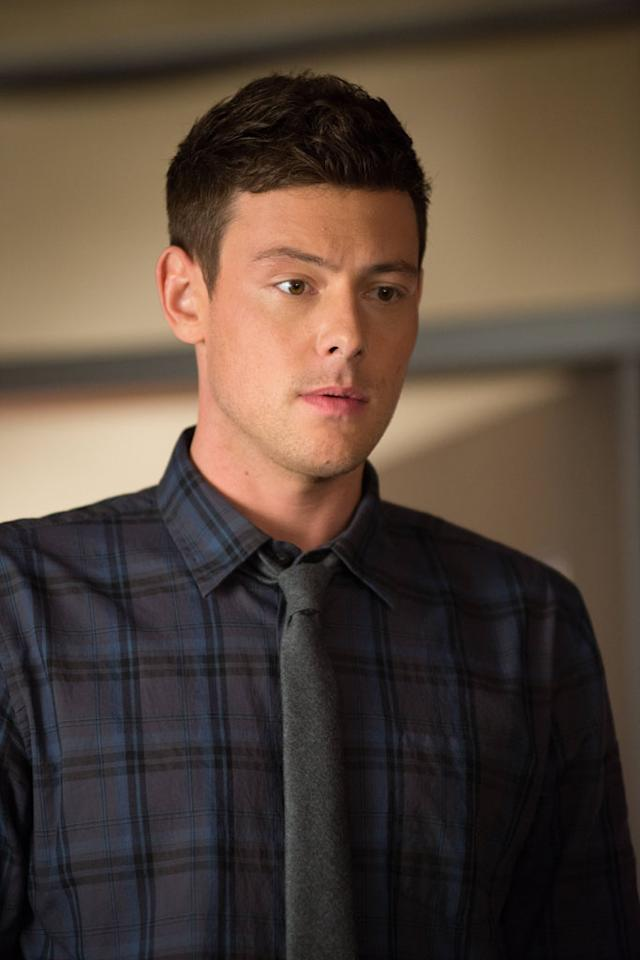 "Finn (Cory Monteith) leads the glee club in the ""Naked"" episode of ""Glee."""