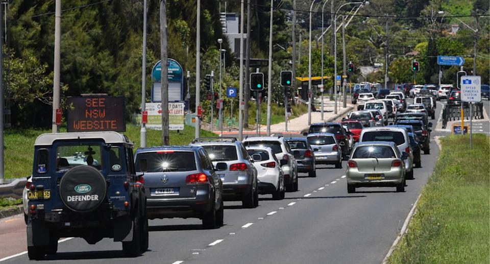 Cars driving on a busy road in Sydney.