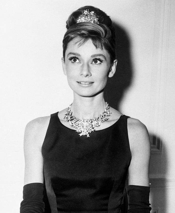 """<p>Iconic film star Hepburn received a posthumous Emmy Award for her documentary specials <em>Gardens of the World with Audrey Hepburn, </em>which filmed in 1990 but didn't premiere until one day after her death in 1993. That Emmy for individual achievement, along with a posthumous Grammy in 1994, made Hepburn the fifth person ever to become <a href=""""https://people.com/awards/egot-winners/"""" rel=""""nofollow noopener"""" target=""""_blank"""" data-ylk=""""slk:an EGOT winner"""" class=""""link rapid-noclick-resp"""">an EGOT winner</a>. </p>"""