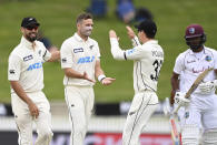 New Zealand's Tim Southee, second left, is congratulated by teammates after dismissing the West Indies' John Campbell during play on day three of their first cricket test in Hamilton, New Zealand, Saturday, Dec. 5, 2020. (Andrew Cornaga/Photosport via AP)