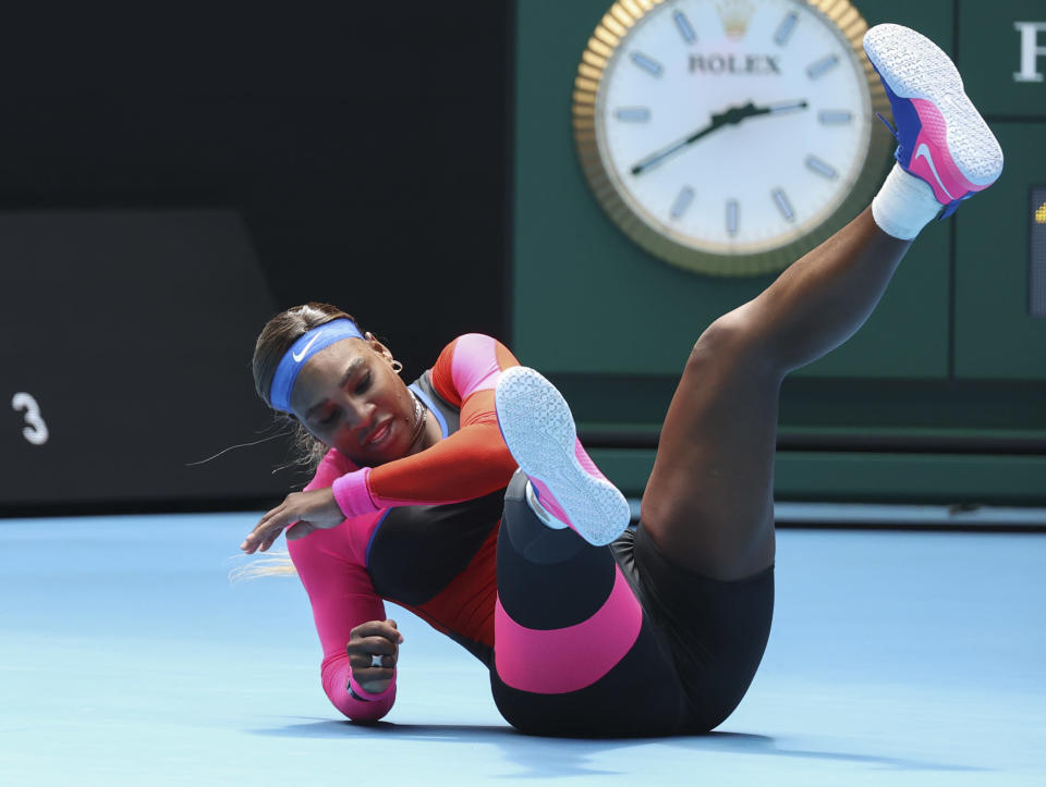 United States' Serena Williams falls during her fourth round match against Aryna Sabalenka of Belarus at the Australian Open tennis championship in Melbourne, Australia, Sunday, Feb. 14, 2021.(AP Photo/Hamish Blair)