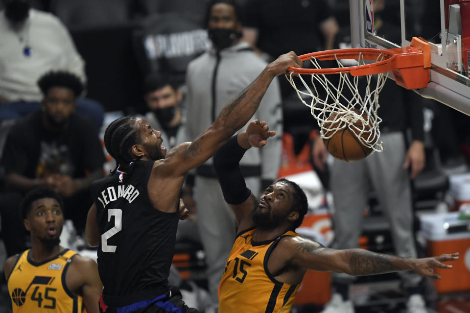 Kawhi Leonard's dunk on Derrick Favors was the highlight of a Game 4 win. (Photo by Kevork Djansezian/Getty Images)