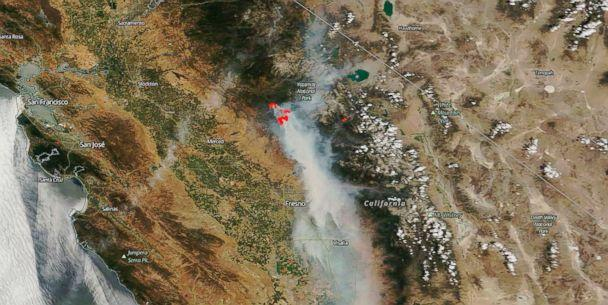 PHOTO: This image captured by NASA's Terra satellite on July 25, 2018, shows actively burning California wildfires (outlined in red) detected bythermal bands. (NASA via AP)