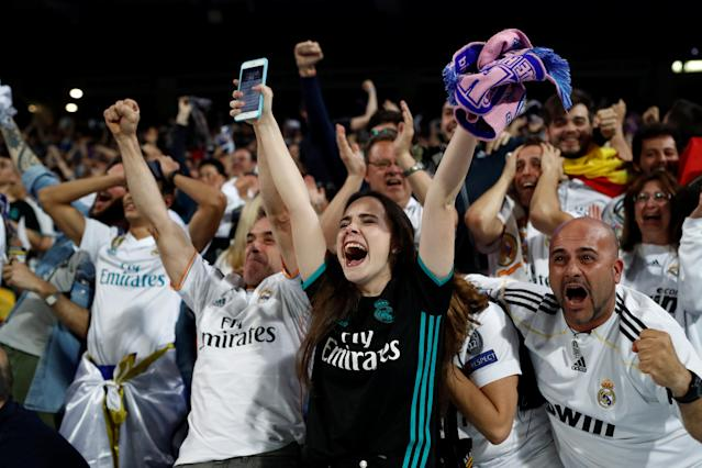 Soccer Football - Real Madrid fans watch the Champions League Final - Madrid, Spain - May 26, 2018 Real Madrid fans celebrate their second goal while inside the Santiago Bernabeu REUTERS/Javier Barbancho