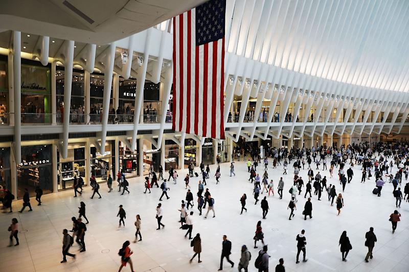 """(Bloomberg) -- There are always crowds at the shopping mall inside the Oculus transit hub in lower Manhattan: commuters rushing to their trains, tourists wandering about after a stop at the nearby 9/11 Memorial & Museum or a photo shoot at the Statue of Liberty.The mammoth, butterfly-shaped Oculus draws as many as 120 million visits each year -- often people passing through on their way to somewhere else. Visitors spend just a little over a half hour on average at the mall, Westfield World Trade Center. Now, its operator has plans to get them to linger longer.""""I'm not sure we need more traffic,"""" Jean-Marie Tritant, U.S. president for Unibail-Rodamco-Westfield, said in an interview. """"We were lacking this kind of offer where people can stay, hang around, have a good time together.""""Eager to remain relevant in the rapidly changing world of retail, URW is adding more food choices, seating, pop-up shops, health and wellness options and entertainment (think virtual reality). The French mall owner, which has 32 shopping centers in the U.S. and is Europe's biggest commercial landlord, is also using loyalty perks and technology to learn more about customer preferences.One category the company doesn't want to expand? Fashion.More Food, Less FashionToday, fashion makes up a little less than half of Westfield World Trade Center's leasable area. URW's goal is to whittle that down to closer to a third, while boosting other offerings, like eateries. Last month, it opened Market Lane, a food hall that includes a bakery, pizza counter and small grocery store. Upgraded dining options could make the Oculus a more-popular hangout for the neighborhood's thousands of transit riders and workers, which collectively make up about 40% of the mall's traffic.Another way to get people to stick around? Give them a place to exercise. Boxing studio Gloveworx opened in the Oculus at the beginning of the year, and Tritant said URW could bring in other niche fitness options, like CrossFit.The landlord"""