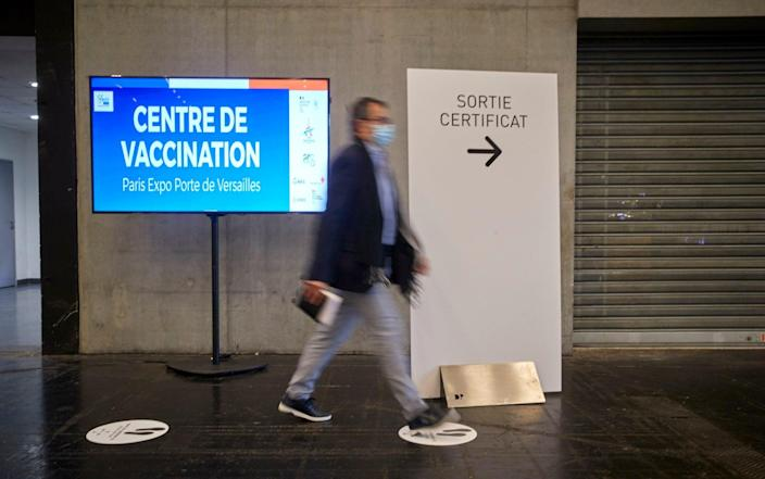 A man leaves the latest mass-vaccination centre, at the National Exhibition Centre, having received his vaccine - Kiran Ridley / Getty