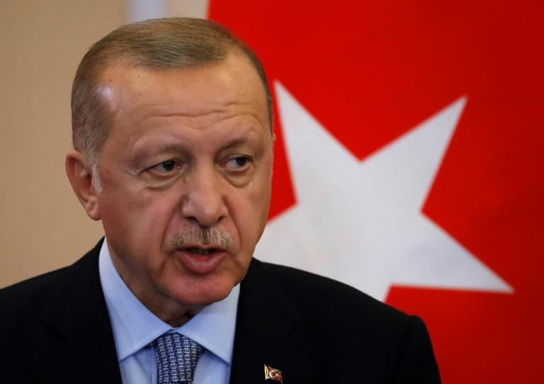 "Turkish President Recep Tayyip Erdogan says he will ""clear terrorists"" from the border between Turkey and northern Syria if Syrian Kurdish militia don't withdraw by Tuesday (AFP Photo/Sergei CHIRIKOV)"