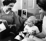 <p>The Queen with her daughter, Princess Anne, and grandson Peter Phillips, during the 1978 Christmas broadcast.</p>