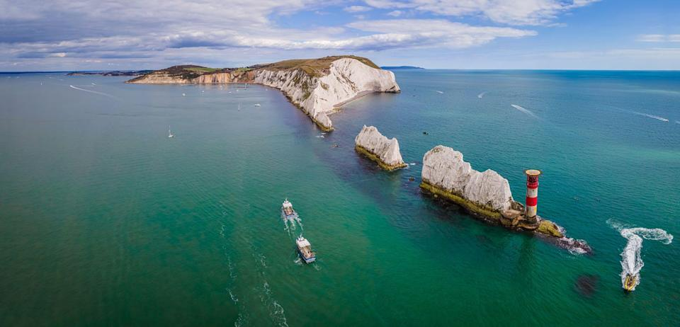 """<p>Vintage beach huts, fossils, homely pubs and modern restaurants – the Isle of Wight is a lovely destination for a quiet few days away. </p><p>Ideal for an island escape in the UK and offering plenty for visitors of all ages, there are many things to do in the Isle of Wight. From Queen Victoria's holiday home <a href=""""https://www.countryliving.com/uk/travel-ideas/staycation-uk/a32314047/osborne-house/"""" rel=""""nofollow noopener"""" target=""""_blank"""" data-ylk=""""slk:Osborne House"""" class=""""link rapid-noclick-resp"""">Osborne House</a> to Ventnor's subtropical garden, you'll fall in love with this scenic isle off Hampshire. </p><p>We've narrowed down a few of the best things to see and do on the Isle of Wight, from wandering the sub-tropical grounds of its historic country houses, to visiting the donkeys and taking tea at Carisbrooke Castle.</p><p>And don't forget to check out Country Living's two exclusive tours to the Isle of Wight, which allow you to <a href=""""https://www.countrylivingholidays.com/tours/england-coast-cowes-week-cornwall-devon-tradewind-cruise"""" rel=""""nofollow noopener"""" target=""""_blank"""" data-ylk=""""slk:celebrate Cowes Week in style on an eco-ship this August"""" class=""""link rapid-noclick-resp"""">celebrate Cowes Week in style on an eco-ship this August</a> or visit the <a href=""""https://www.countrylivingholidays.com/tours/isle-of-wight-gardens-osborne-walkden-tour"""" rel=""""nofollow noopener"""" target=""""_blank"""" data-ylk=""""slk:glorious gardens with TV expert Christine Walkden in May 2022"""" class=""""link rapid-noclick-resp"""">glorious gardens with TV expert Christine Walkden in May 2022</a>.</p>"""